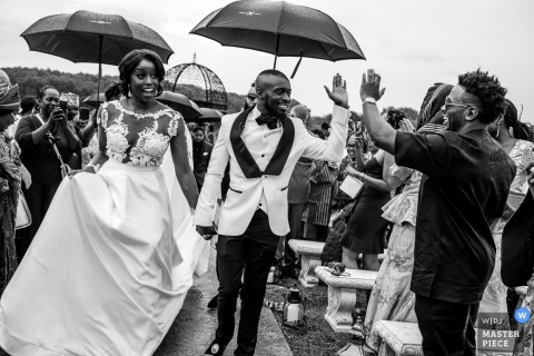 Outdoor wedding photography in the rain at Bavaria Downs in Minnesota,	Bride and Groom Recessional