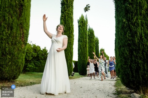 Valence, France Wedding Photo Contains: Throwing the bouquet in Provence