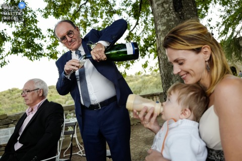 Aumelas, France wedding image contains: Drinking all together, kids, adults, reception, trees
