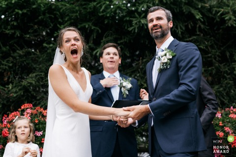 Outdoor wedding venue photography from La Chemenaz , Les Contamine-Montjoie France - Funny moment with bride during ceremony