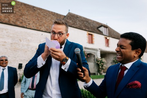 Relais de Neuville Gambais France wedding venue photography: Funny moment between groomsman and groom