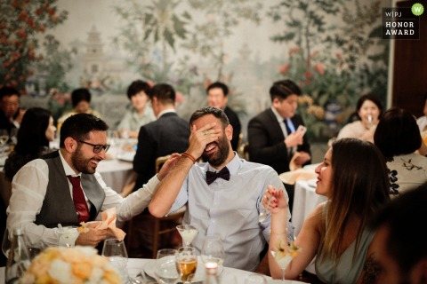 Wedding venue photo from luxembourg, château des sept fontaines | guests laughing during wedding reception