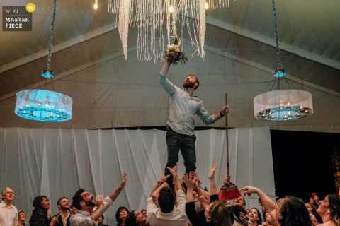 Jardin Etnobotanico, Oaxaca City, Oaxaca, Mexico image contains: Wedding guests rescuing the bouquet stuck in the chandelier