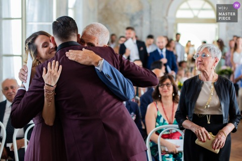 Sagrado - Castelvecchio Family emotions capture in great wedding photos.