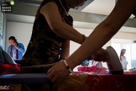 Fujian Hotel Photo of Getting ready. Steam ironing the clothing before the ceremony