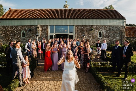 The bride is scared she has thrown her bouquet to high at Penteny Abbey, Norfolk - wedding pictures