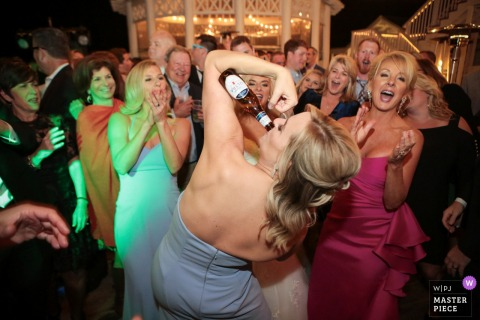 Watercolor Florida, reception wedding image contains: Bridesmaid showing off their muscles.