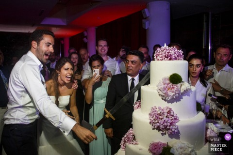 istanbul, esma sultan yalisi | cake cutting with a huge sword