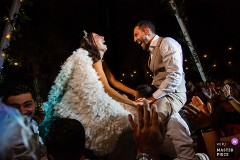 Fethiye, Turkey - Help Beach Club	wedding photography showing the couple in the air at after party