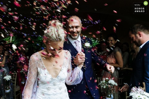 Horsham, West Sussex, England, UK wedding venue photography - The bride and groom confetti shot