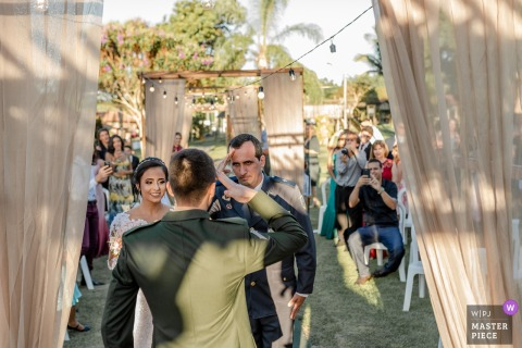 Outdoor Wedding Ceremony Venue: Cerimonial Sítio Santa Clara - Aracruz, Espírito Santo, Brazil - Photo of the Bride's father (High Patent Police Officer) saluting the groom (Brazil's army officer)