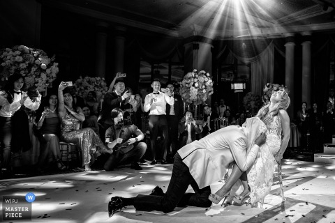 Bangkok Garter removal - wedding photography from the dance floor of the bride and groom