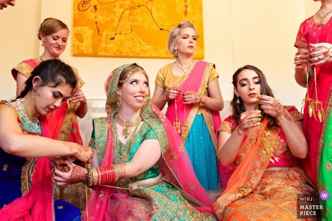Illinois Bride getting ready image contains: Indian pre-wedding ceremony of bride and parents, bridal party