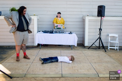 Stanford House at Oakland, CA Wedding Photo: The boy don't want get up on the dance floor and made funny faces with his dad