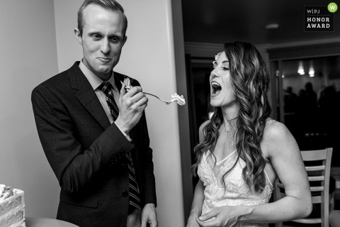 Vacation Rental Property, Oceanside, California wedding photo: The groom teases the bride with cake.