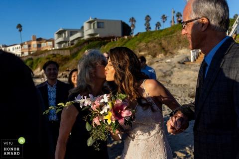 Outdoor, beach wedding venue photo from Windansea Beach, San Diego, California. - The brides parents walk her down the aisle.