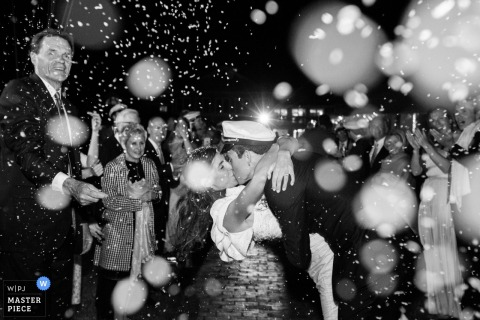Nantucket Yacht Club, Wedding Reception Photo - Bride and Groom exiting the ceremony under an ecofetti celebration.