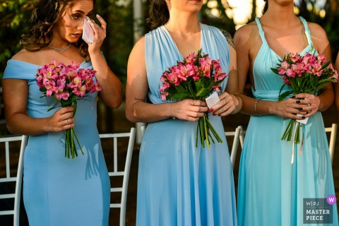 Floriada eventos em Holambra - Wedding photo of Bridesmaid crying during outdoor ceremony.