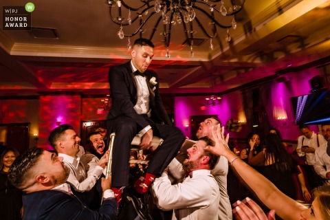 Wedding Photo from the NY Venue: Royalton on the Greens - Groom is lifted on a chair