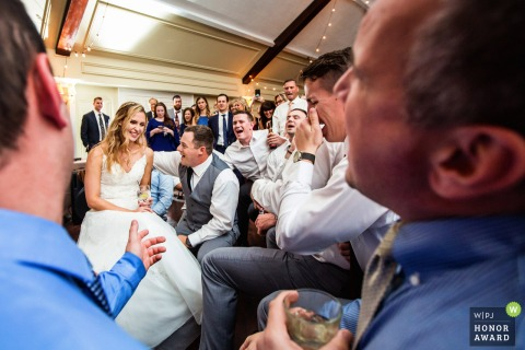 Wedding Photojournalism | Group of guys serenade bride on dance floor at Lake Mohawk Country Club, New Jersey wedding venue