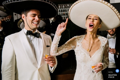 Panama wedding reception photo of the bride and groom making a toast