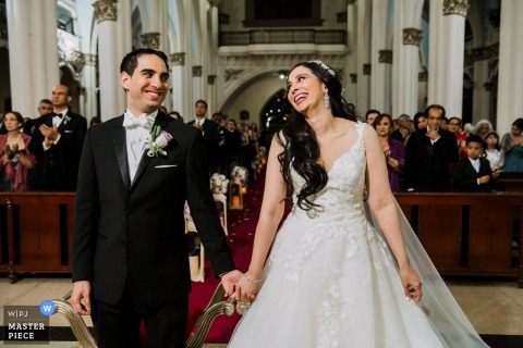 Wedding Photographer for Panama - Picture from the ceremony, a natural and emotional smile of the bride during ceremony