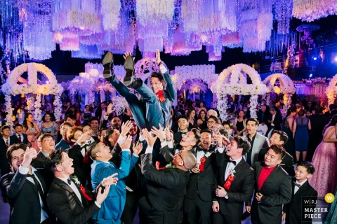 Panama wedding reception photo of the groom tossing