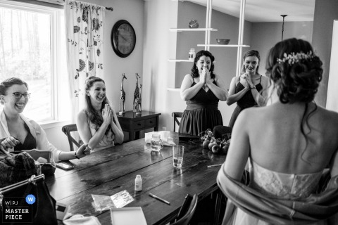 Wedding photograph from Indian Ridge Wedding Venue, Poughkeepsie NY | Four bridesmaids see the bride for the first time and all put their hands together in the same adoring fashion
