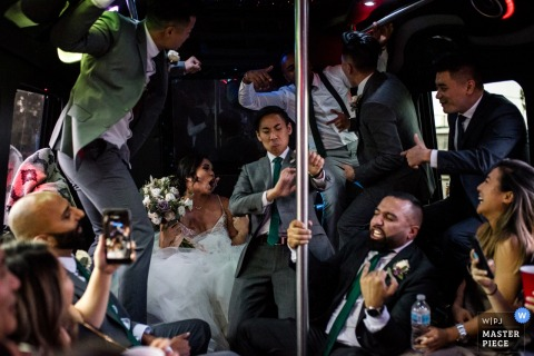 British Columbia Canada wedding photography of the dance party on the bus en route to the reception