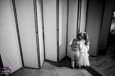 Square Tower, Portsmouth, UK wedding reportage: Page boy and flower girl sneak a peek of the bride