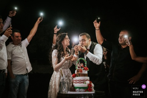 Dren, Sofia wedding photograph from the reception party | Bride and Groom cut the cake