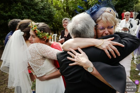 Beziers, France Family love | Wedding day photos of hugs