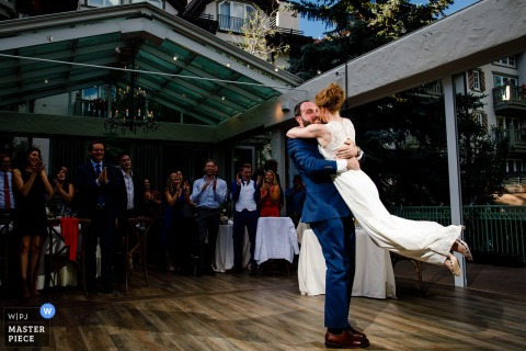 Vail, CO wedding photographer: The groom lifting his bride during their first dance.