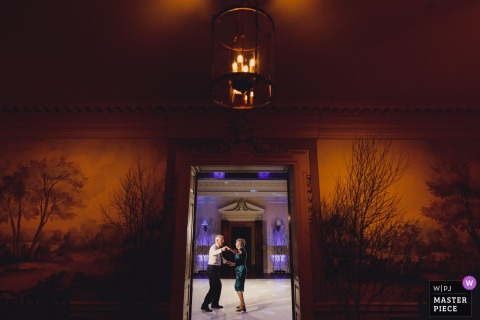 Hedsor House UK wedding reportage photos of an old couple on dance floor alone