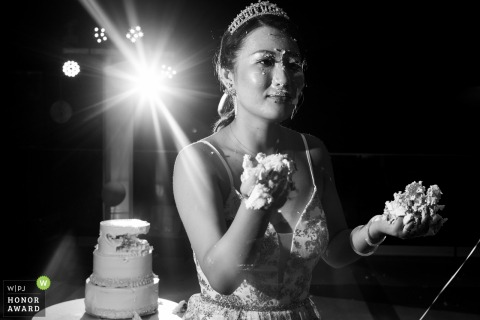 cancun riu costa mujeres wedding venue photo - Bride prepares for revenge with cake