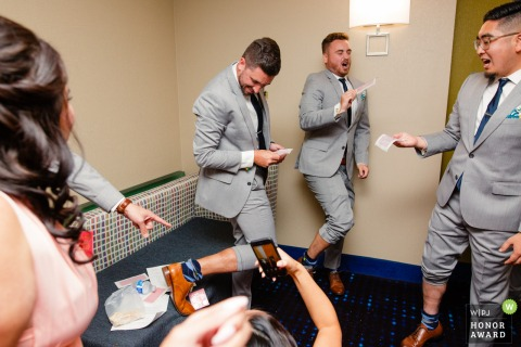 Holiday Inn Express, CA wedding photo - Door game, The best man is required to stick leg hair with adhesive tape