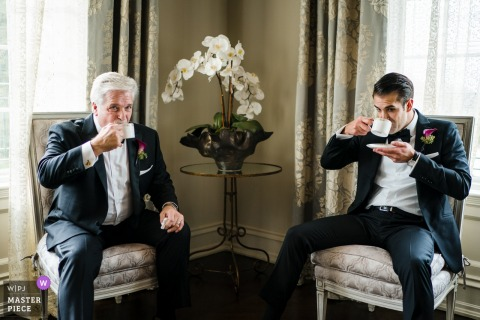 Wedding Day Venue Photography | The Brides Father and her Brother sipping tea as they wait on guests to arrive so they can start the ceremony.