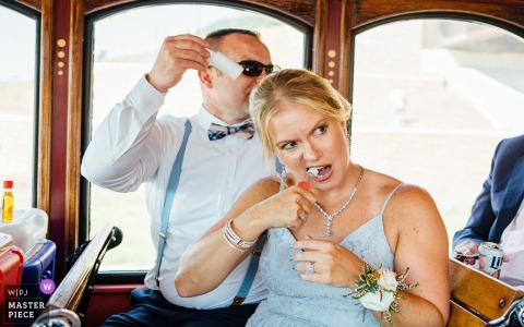 Ollie the Trolley, Omaha, NE (party bus)	| Bridesmaid opening a bottle of Fireball with her teeth! Groomsman passing out more shots of Fireball