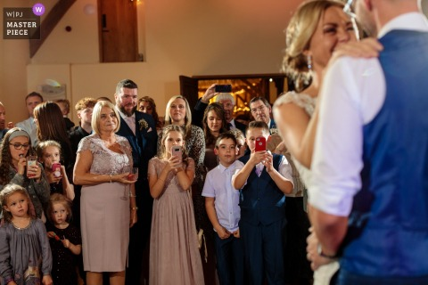 Winters Barns, Canterbury, Kent, UK wedding venue photography | The brides mother and family onlook as the couple have their first dance