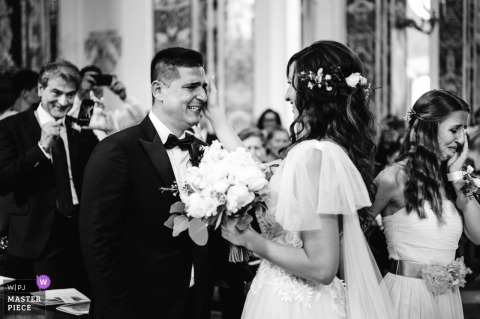 Ceremony in the church, Puglia, Italy | Photo of an exciting moment of the arrival of the bride with her daughter to the groom