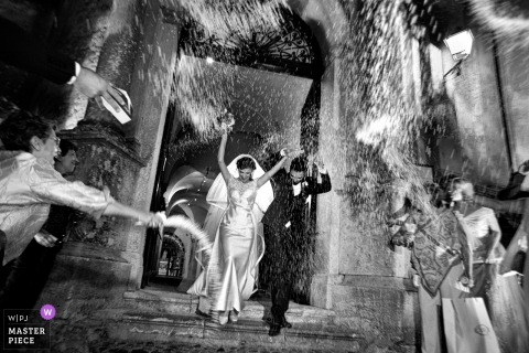 Cattedrale di Gerace, Gerace, Reggio Calabria Wedding Photos | Rice toss as the bride and groom leave the church at night.