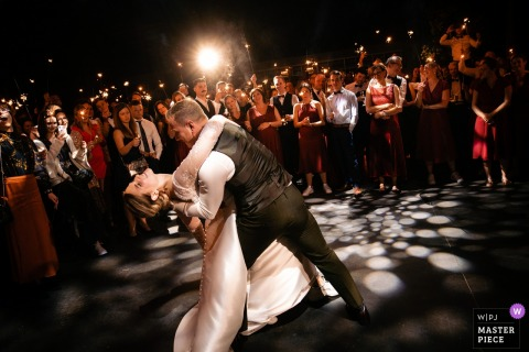 Antwerpen wedding photographer: The grooms dips his bride in the grand finale of their first dance