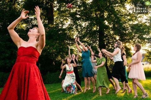 Flanders Outdoor Reception Photography - The bride tosses her bouquet and the crowd gets wild!