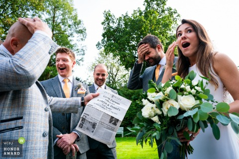 Old Rectory House, UK wedding venue reception photo - Bride and Groom react to magic trick.
