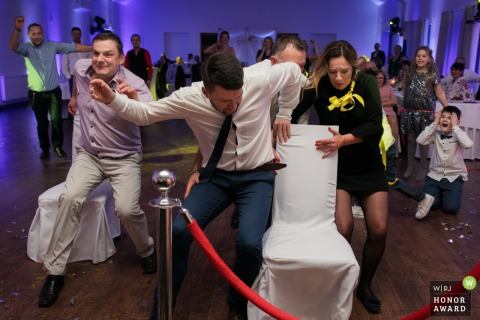Krakow wedding photographer in Malopolskie at the Reception Venue with a crazy contest