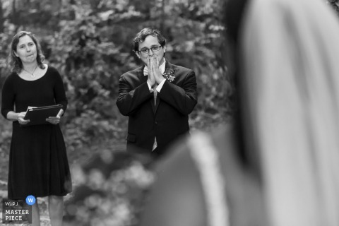 Tucker, GA Backyard Wedding | Groom reacts as he sees his bride coming down the aisle