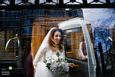 England wedding reportage photography from The Landmark Hotel of the Bride going to ceremony