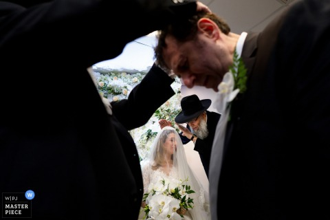 Kinloss Synagogue Wedding Photography | Blessings being given to the bride and groom