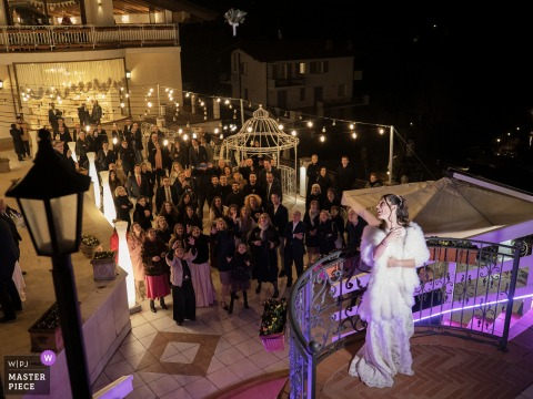 Il Fontanile, Gandosso, Italy Wedding Reception | The bride launches her bouquet into the crowd