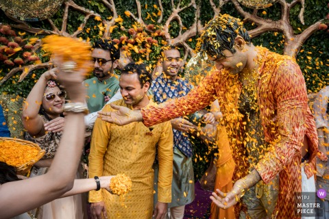 Delhi, India Wedding Photography | Turmeric and flower throwing